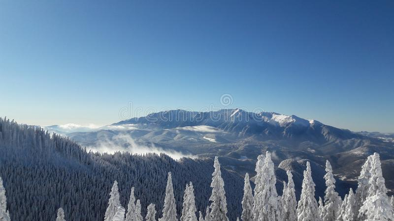 Winterscape of Bucegi mountains in the Carpathian range stock photo