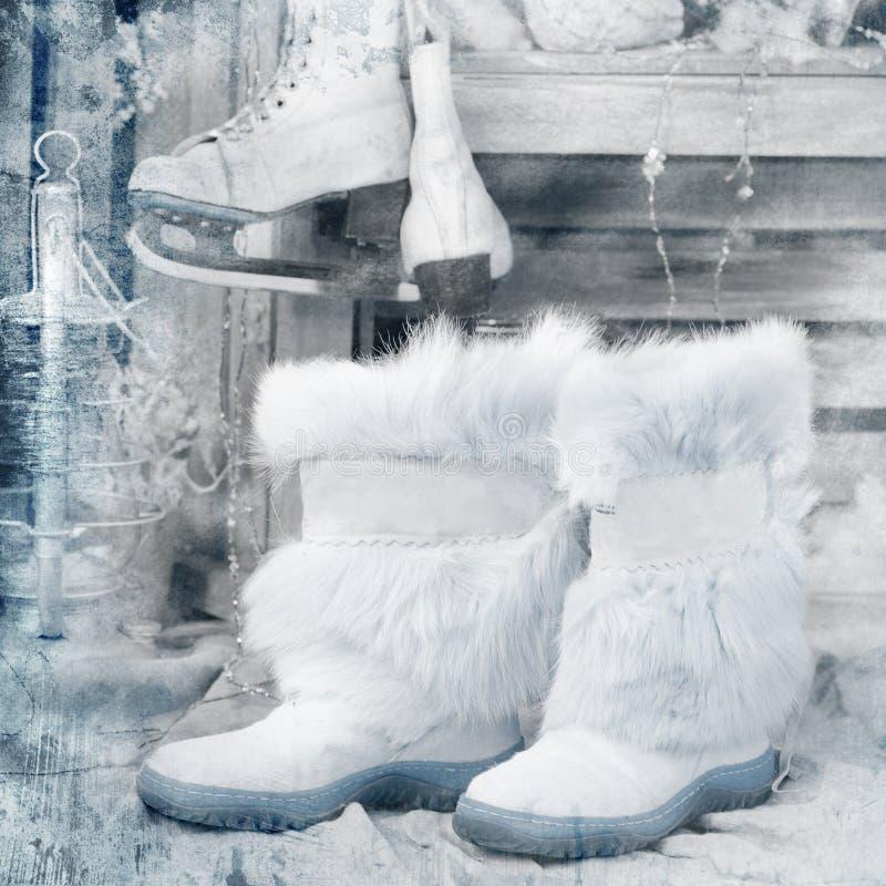 Weinleseartbild mit Winterstiefeln lizenzfreie stockbilder