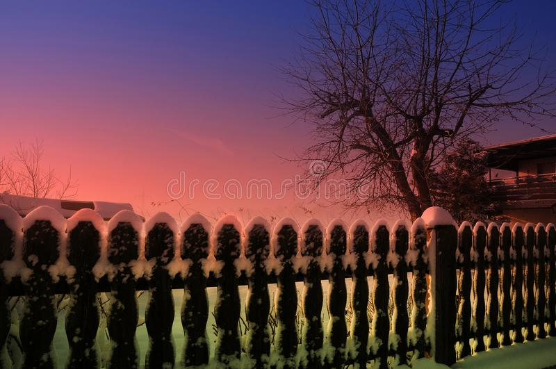 Wintertime, garden and fence of my neighbor covered with s. Snow is a very special thing where I live. Only a few days in the year landscape is covered with snow royalty free stock images