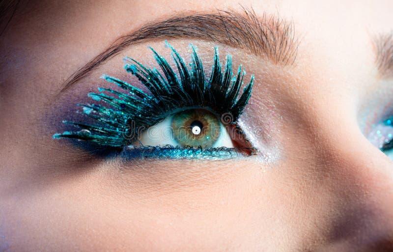 Wintry Creative Eye Makeup. False Long Blue Eyelashes stock photo