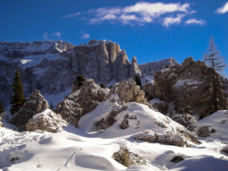 Wintry Dolomites mountains. Winter view of mountain landscape from Sella pass in a sunny day - Dolomites, Italy 2007 stock image