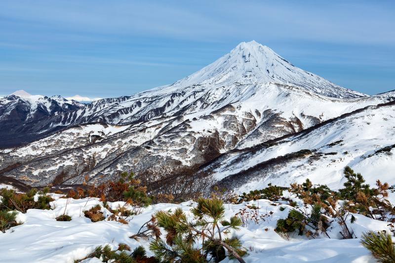 Wintry mountainous landscape - snow-capped cone of volcano royalty free stock photo