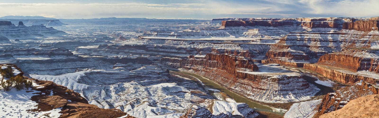 Dead Horse Point Colorado River Winter Panorama. Wintry view of a gooseneck bend in the Colorado River from the overlook in Dead Horse Point State Park Utah royalty free stock photos