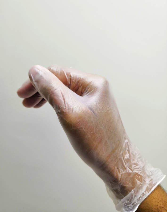 Winylowa rękawiczka W ręce obrazy stock