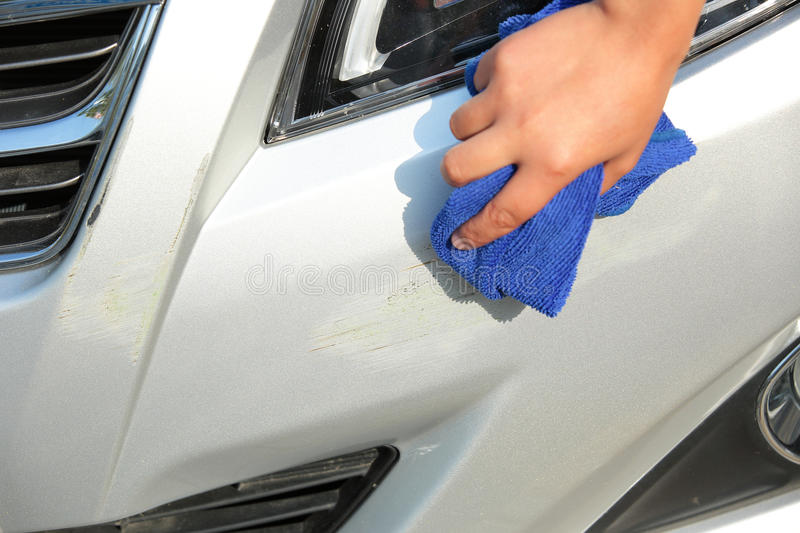 Wipe Off The Scratches On Car Stock Photo