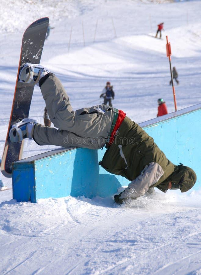 Wipeout del Snowboarder foto de archivo