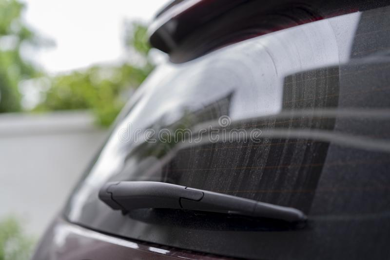 Wiper at back mirror of the card with dirty and dust on it. it can use in service washing / cleaning car care royalty free stock photos
