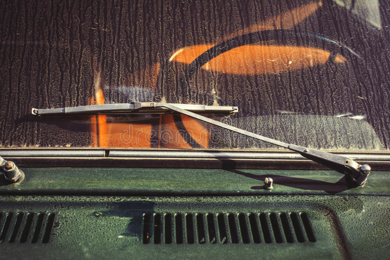 Wiper on car. Old rusty classic car. Abandoned car in yard stock photography