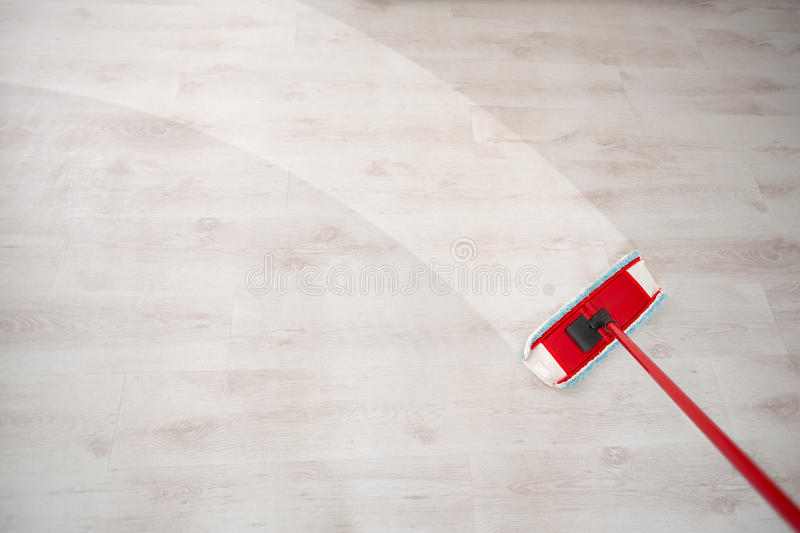 Wiping floor and cleaning stock photo