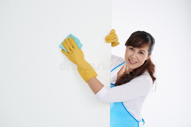 Wiping wall stock photo