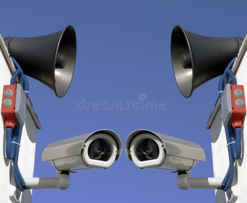 Wir überwachen Sie stockfotografie
