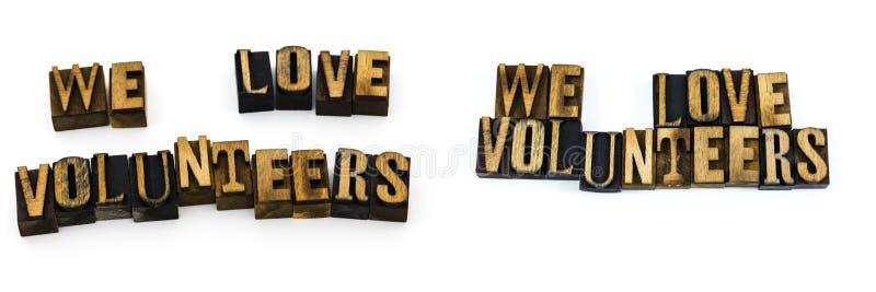 Wir lieben das Freiwilligmitteilungshelfen stockfoto