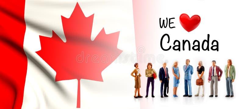 Wir lieben Kanada, a-Gruppe von Personenen-Haltung nahe bei der kanadischen Flagge stock abbildung