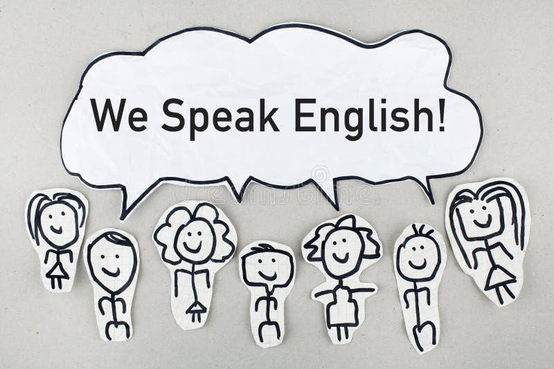 Wir sprechen Englisch/Kommunikations-sprechendes Konzept lizenzfreie stockfotografie