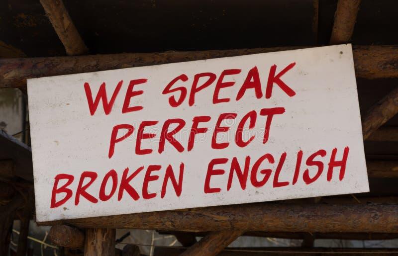 Wir sprechen perfektes gebrochenes Englisch stockbilder