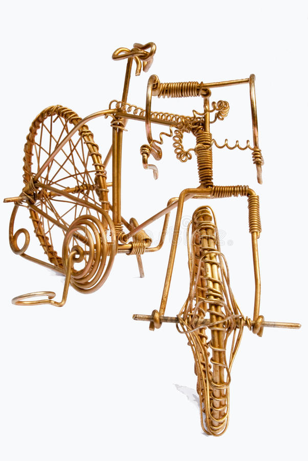 Wire Art Bicycle. Miniature wire art bicycle, made of bronze wire, on white background royalty free stock images