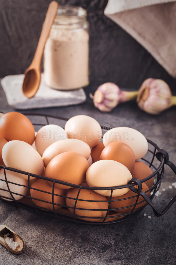 Wire basket with eggs on rustic table royalty free stock photos