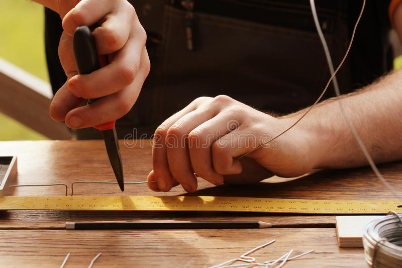 Wire bending with pliers stock photos