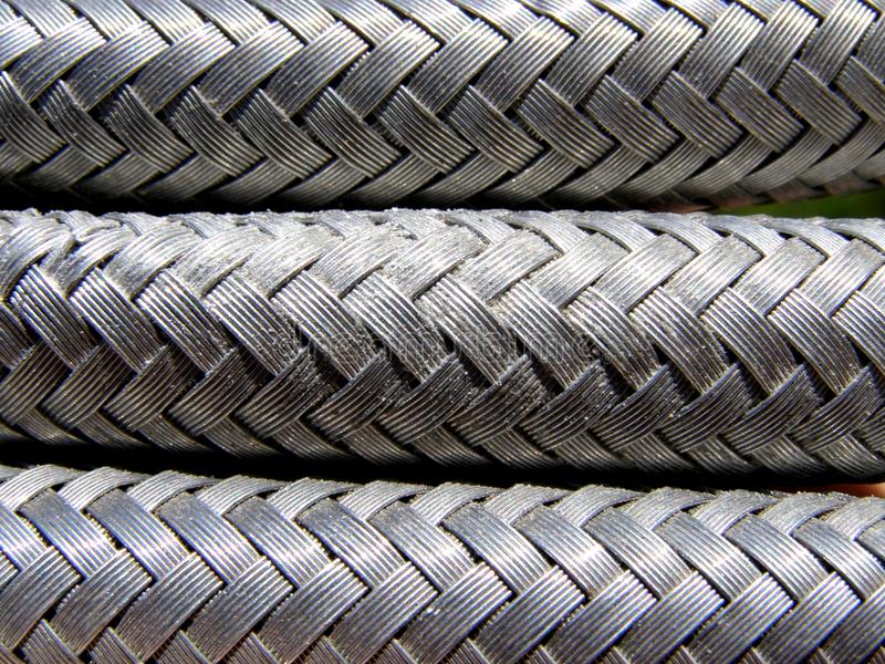 Wire braided hose. Detail photo texture of the wire braided hose background stock photography