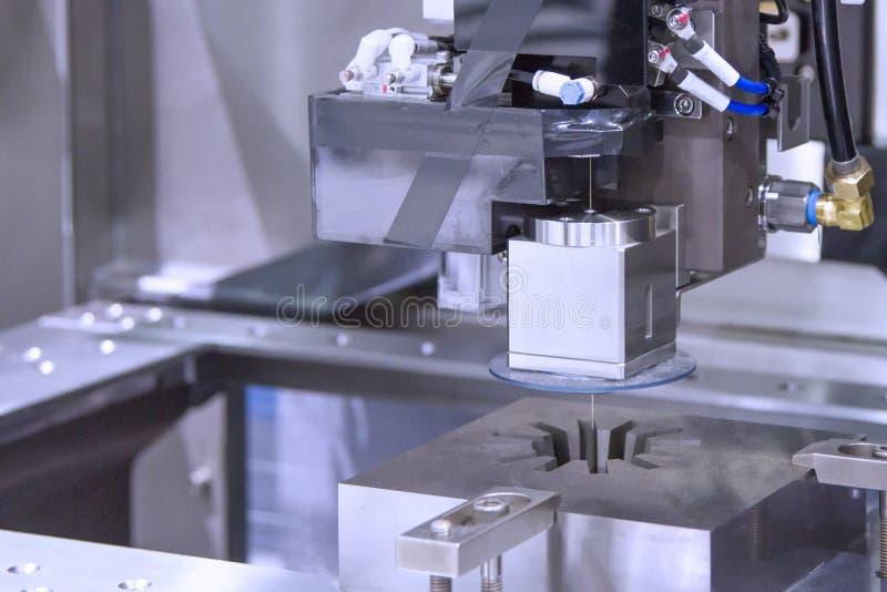Wire cutting machine cutting metal royalty free stock photo