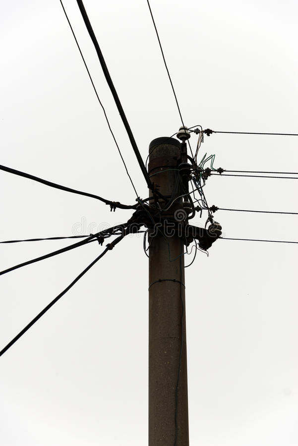 Wire distribution. Post with power/telecommunication lines in poland stock photography