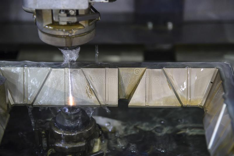 The wire EDM machine cutting  the mould parts . stock images