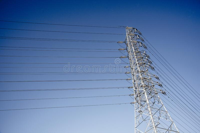 Wire Electric Telecom post. And cable wth blue sky background, tower, white, telecommunication, antenna, cellular, technology, industry, steel, network stock photos