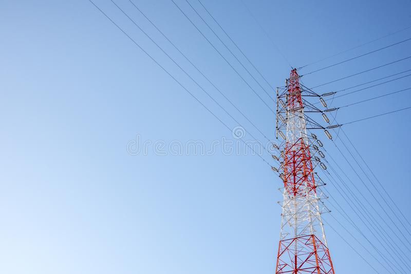 Wire Electric Telecom post. Red and white wired Electric cable Telecom post with blue sky background, technology concept, tower, telecommunication, antenna stock image