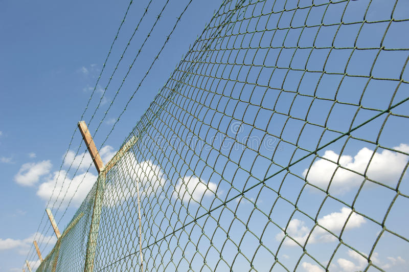 Wire fence. Iron fence used to security and prevent stock photography