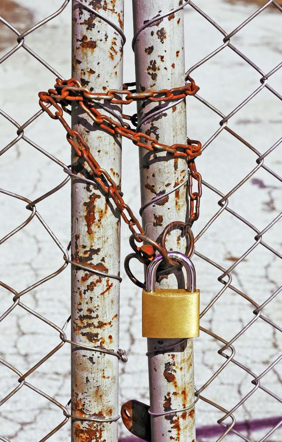 Wire fence with a chain and a lock stock image