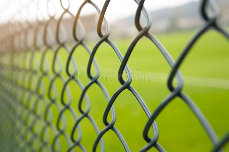Wire fence or metal net on sunset and green background stock photos