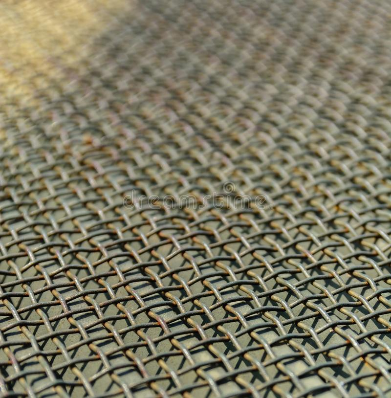 Wire metal mesh or grille. Perspective and blur. Industrial background. stock photos