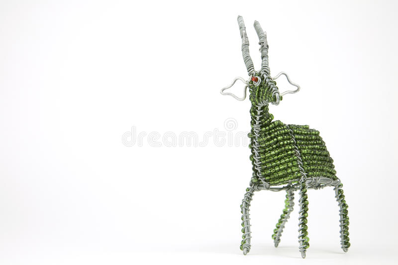 Wired and beaded African animal Craft of a Buck isolated on a white background royalty free stock images
