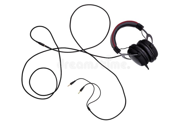 Wired black gaming headset with whole wire isolated on white background in flat lay composition. Top-down stock photos