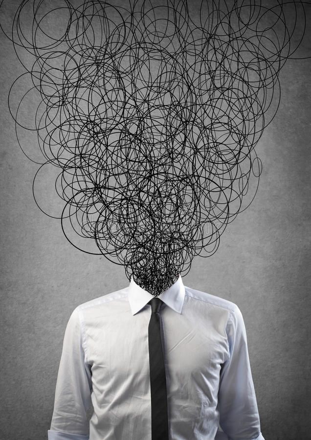 Wired Man. Office worker has many wires instead of the face stock photo