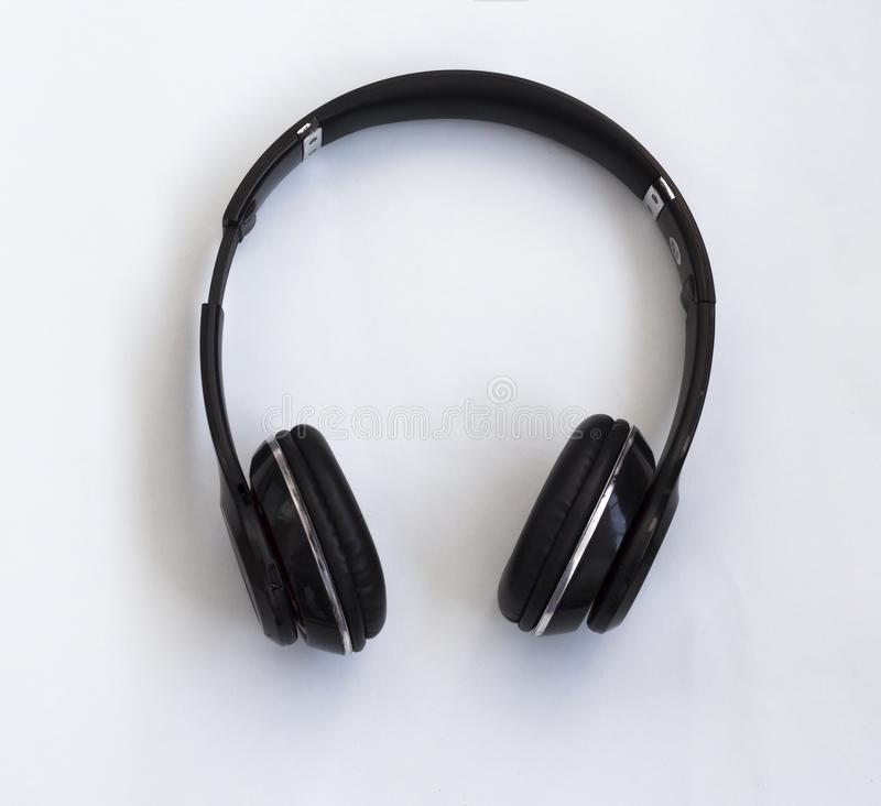 Wireless Bluetooth headphones for listening to music, watching movies and answering phone calls.  stock photo