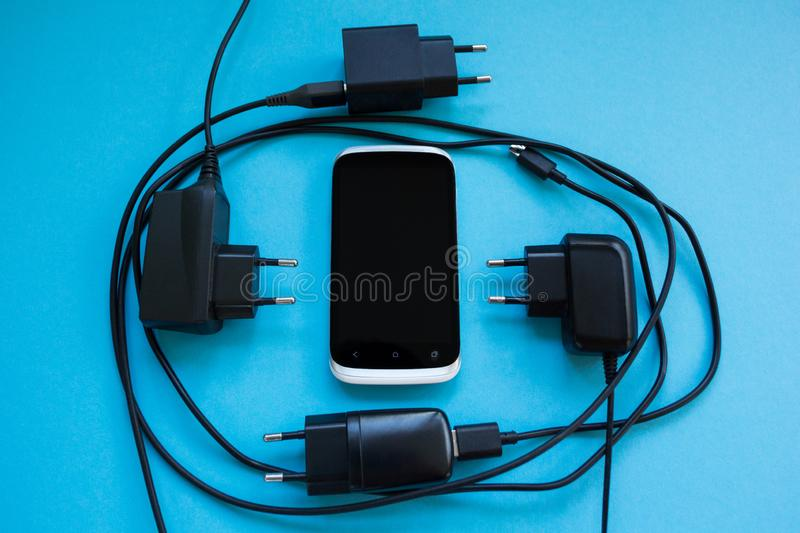 Wireless charging for smartphone on a blue background, concept royalty free stock photos