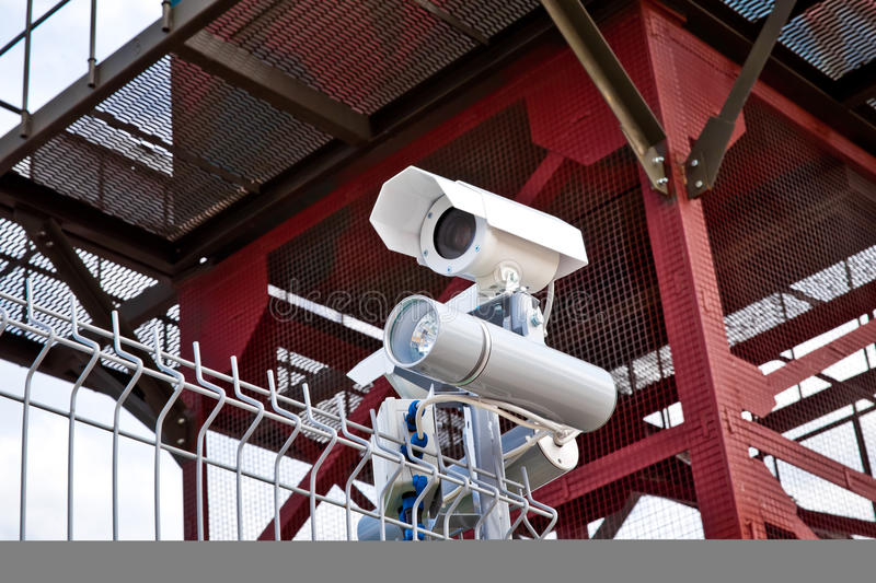 Wireless color security camera with night vision. On the fence royalty free stock image