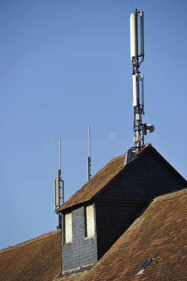 Wireless Communication. Antennas for wireless communication on an old farming house stock photography