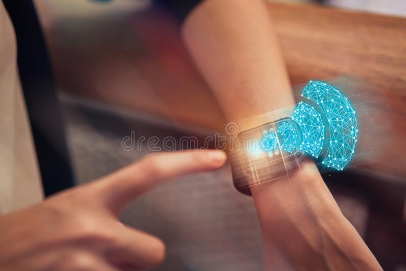 Wireless and connection network technology concept, woman touching on smart watch with show wifi icon at the mall. stock photo