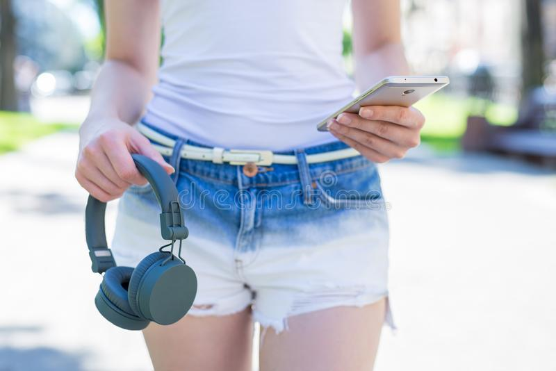 Wireless head phones concept. Cropped close up view photo of stylish trendy confident attractive pretty beautiful lady holding usi royalty free stock photos