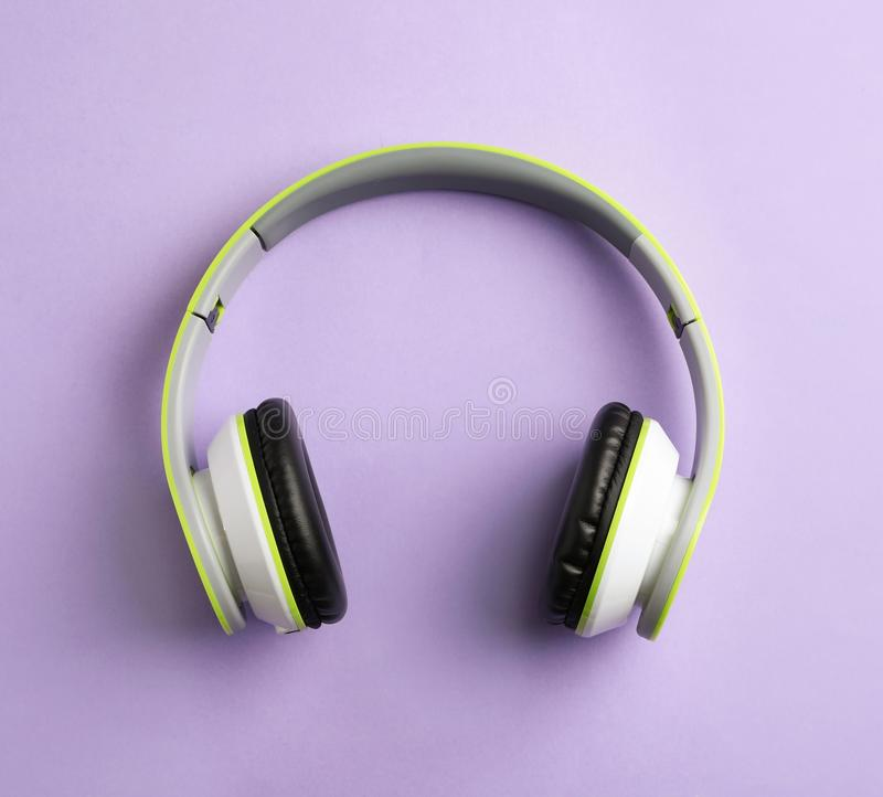 Wireless headphones on color background. Top view royalty free stock photography