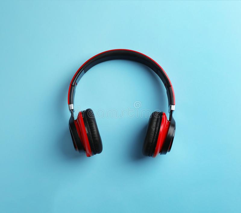 Wireless headphones on color background. Top view royalty free stock image