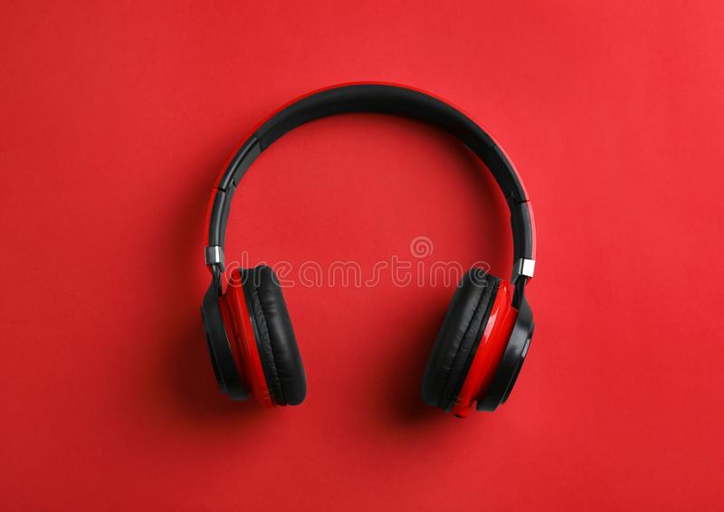 Wireless headphones on color background. Top view royalty free stock photos