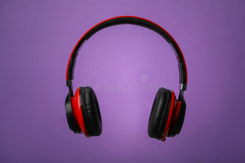 Wireless headphones with earmuffs. On color background royalty free stock image