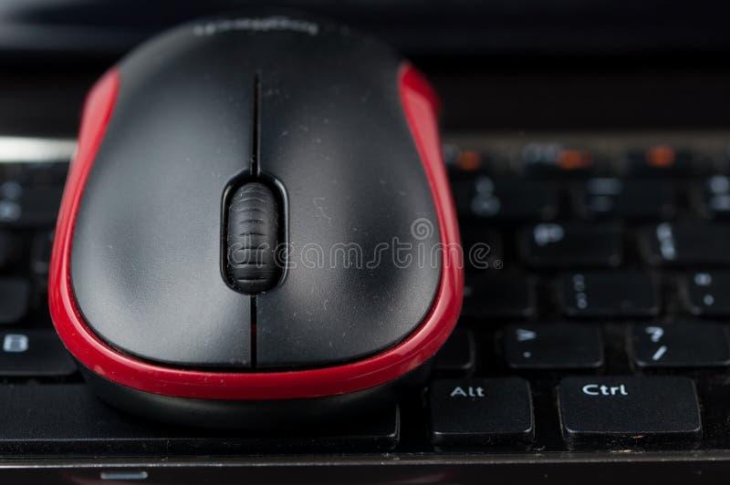 Wireless mouse on keyboard.Laptop on desk stock photo