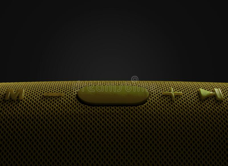 Wireless music column. Yellow wireless speaker with bass. Control and volume buttons stock photography