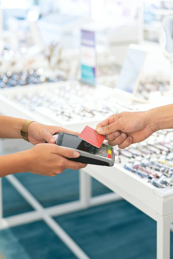 Wireless payment at an optical retail shop royalty free stock photography