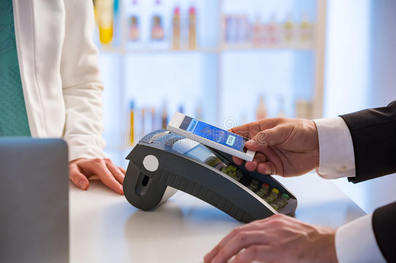 Wireless payment using smartphone and NFC technology. stock photos