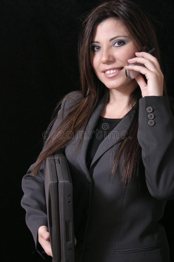 Wireless working girl. Woman with cellphone, and laptop - wireless communications stock images